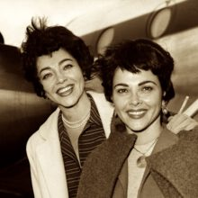 The Barry Sisters, Merna (left) and Claire, arrive in the UK from America, to sing at the Colony Restaurant, 3rd October 1958. (Photo by J. Wilds/Keystone/Hulton Archive/Getty Images)